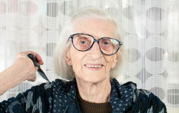 Senior woman holding a comb Royalty Free Stock Image