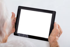 Senior Woman Holding Digital Tablet Stock Photos