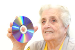 Senior woman holding dvd Stock Images