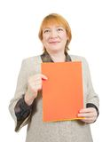 Senior woman holding on empty red poster Royalty Free Stock Photography