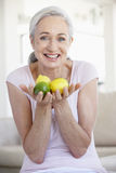 Senior Woman Holding Fruit Stock Image