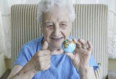 Senior woman holding a globe Royalty Free Stock Photo