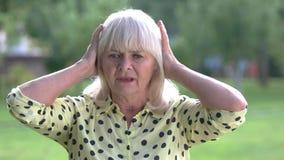 Senior woman holding her head. stock video