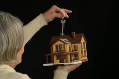 Senior woman holding  house Royalty Free Stock Image