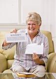 Senior woman holding innernotification Stock Photo
