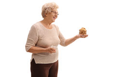 Senior woman holding a jar of cookies Royalty Free Stock Photo