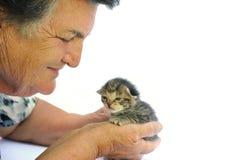Senior woman holding kitten Royalty Free Stock Photo