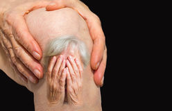 Senior woman holding the knee with pain Royalty Free Stock Photo