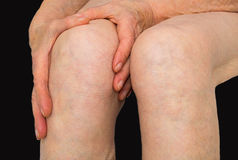 Senior woman holding the knee with pain Stock Photography