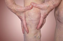 Senior woman holding the knee with pain Royalty Free Stock Photography