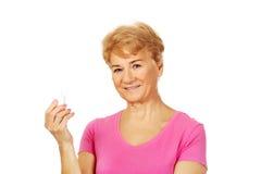 Senior woman holding medicament bottle Stock Photo
