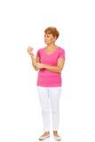 Senior woman holding medicament bottle Royalty Free Stock Photography