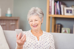 Senior woman holding mobile phone Stock Photography