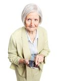 Senior woman holding mobile phone over white Royalty Free Stock Images