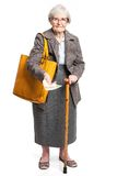 Senior woman holding money while standing on white Stock Photography