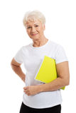 Senior woman holding a note Stock Image