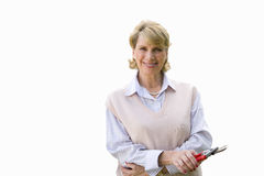 Senior woman holding pair of plant clippers, cut out Royalty Free Stock Photo