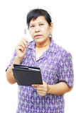 Senior woman holding a pen Royalty Free Stock Images