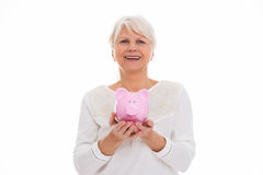 Senior woman holding piggy bank Stock Image