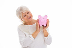 Senior woman holding piggy bank Royalty Free Stock Photo
