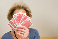 Senior woman holding playing cards Stock Photography