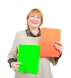 Senior woman holding posters Royalty Free Stock Images