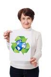 Senior woman holding recycling symbol. Mature woman holding recycling symbol Royalty Free Stock Image