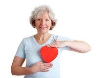 Senior woman holding red heart Stock Images