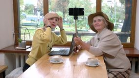 Senior woman holding selfie stick. stock footage