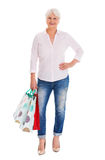 Senior woman holding shopping bags Royalty Free Stock Image