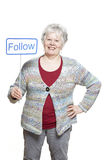 Senior woman holding a social media sign smiling Royalty Free Stock Photos