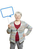 Senior woman holding a speech bubble sign smiling Stock Images