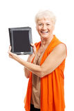 Senior woman holding a tablet Stock Photos