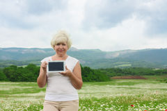 Senior woman holding tablet pc Royalty Free Stock Photography