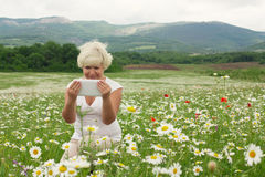 Senior woman holding tablet pc Royalty Free Stock Photo