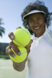 Senior Woman Holding Tennis Balls Royalty Free Stock Image