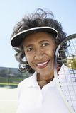 Senior Woman Holding Tennis Racquet Royalty Free Stock Image