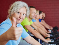 Senior woman holding thumbs up Stock Images