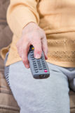 A senior woman holding (using) remote control Stock Photo