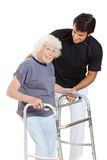 Senior Woman Holding Walker While Trainer Stock Image