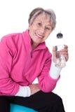 Senior woman holding water bottle Stock Image