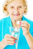 Senior Woman Holding Water Glass And Tablet Stock Photography