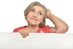 Senior woman holds banner Stock Images
