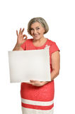 Senior woman holds banner Royalty Free Stock Photo