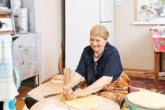 Senior woman holing the bread Royalty Free Stock Photos