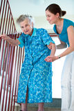 Senior woman with home caregiver Stock Image