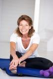 Senior woman at home exercising stock photo