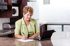 Senior woman home finance Stock Photo