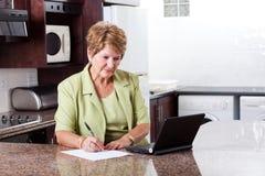 Senior woman home finance Stock Photo