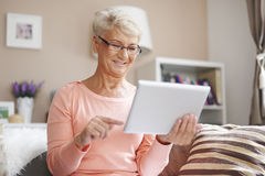 Senior woman at home Stock Images